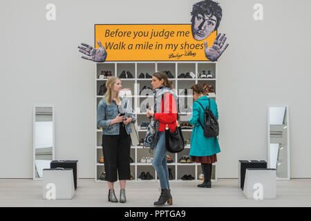 London, UK. 27th Sep 2018. Bedwyr Williams' Walk A Mile In My Shoes, a display case with 45 pairs of his own size 13 shoes. He invites the audience to share in his own 'problems of podietry ' by trying them on - Black Mirror the new exhibition at the Saatchi Gallery about art's role in social satire - featuring the work of 26 contemporary artists. It runs from 28 Sept 18 to 13 Jan 19. Credit: Guy Bell/Alamy Live News - Stock Photo