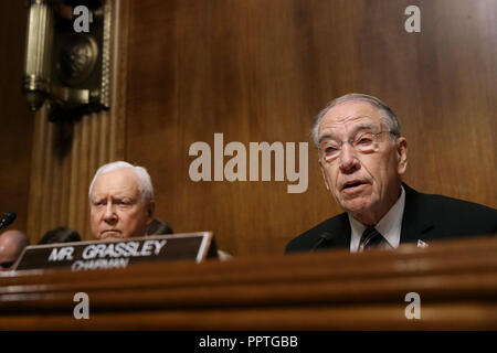 WASHINGTON, DC - SEPTEMBER 27: Senate Judiciary Committee Chairman Charles Grassley (R-IA) (R) delivers an opening statement before hearing from Christine Blasey Ford during a hearing with Sen. Orrin Hatch (R-UT) in the Senate Judiciary Committee in the Dirksen Senate Office Building on Capitol Hill September 27, 2018 in Washington, DC. A professor at Palo Alto University and a research psychologist at the Stanford University School of Medicine, Ford has accused Supreme Court nominee Judge Brett Kavanaugh of sexually assaulting her during a party in 1982 when they were high school students in - Stock Photo
