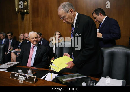 WASHINGTON, DC - SEPTEMBER 27: Senate Judiciary Committee Chairman Charles Grassley (R-IA) (C) and committee members Sen. Ted Cruz (R-TX) (R) and Sen. Orrin Hatch (R-UT) prepare for the arrival of Christine Blasey Ford in the Dirksen Senate Office Building on Capitol Hill September 27, 2018 in Washington, DC. A professor at Palo Alto University and a research psychologist at the Stanford University School of Medicine, Ford has accused Supreme Court nominee Judge Brett Kavanaugh of sexually assaulting her during a party in 1982 when they were high school students in suburban Maryland. Credit: - Stock Photo