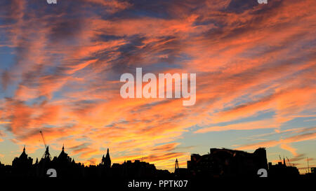 London, UK, 27h Sep 2018. A beautiful sunset  concludes a warm and sunny day in London as the skyline along the Strand in Westminster is silhouetted against the colourful sky. Credit: Imageplotter News and Sports/Alamy Live News - Stock Photo