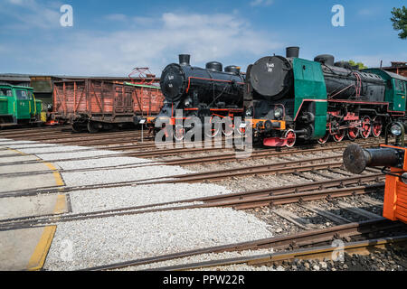 Jaworzyna Slaska, Poland - August 2018 : Old disused retro train locomotives and carriages on the side tracks in the depot in the Museum of Industry a - Stock Photo