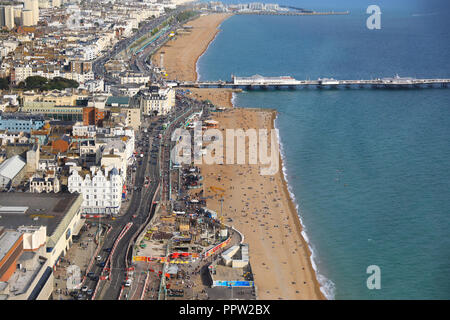 View of Palace Pier and the beach from the viewing pod of the Brighton i360, on the seafront, in East Sussex, in the UK - Stock Photo