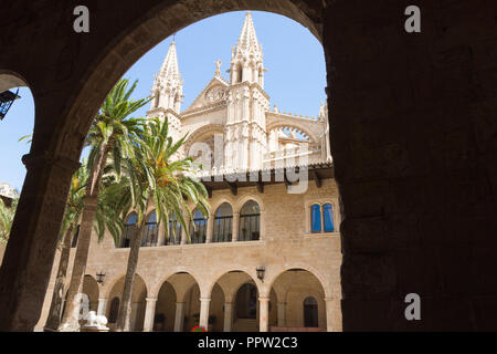 Almudaina Palace exterior view with La Seu Cathedral towers in background. Palma de Mallorca, Balearic islands, Spain. Travel destination - Stock Photo