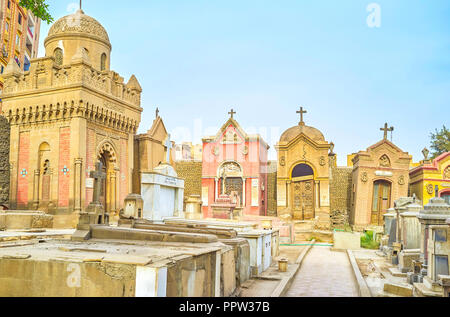 CAIRO, EGYPT - DECEMBER 23, 2017: The old decrepit crypts and tombs in medieval  cemetery in Coptic district, on December 23 in Cairo - Stock Photo