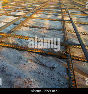Construction workers fabricating steel reinforcement bar at the construction site 2018 - Stock Photo
