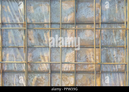 Abstract background of iron armature ready for concreting Metal armature in reinforced concrete structures close-up 2018 - Stock Photo