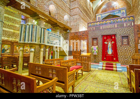 CAIRO, EGYPT - DECEMBER 23, 2017: The beautiful sanctuary screen decorated with geometrical carved patterns with two royal doors on the sides, on Dece - Stock Photo