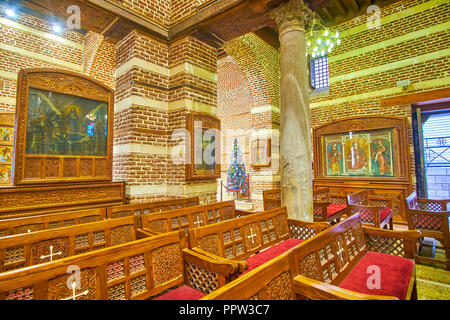 CAIRO, EGYPT - DECEMBER 23, 2017: The prayer hall of St Barbara Church decorated with ancient icons in byzantine style, on December 23 in Cairo. - Stock Photo