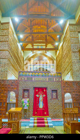 CAIRO, EGYPT - DECEMBER 23, 2017: The beautiful carved wooden screen separates sanctuary from the prayer hall, and equipped with two royal gates on it - Stock Photo