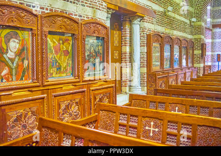 CAIRO, EGYPT - DECEMBER 23, 2017: The beautiful ancient Byzantine style icons in the prayer hall of St Barbara Church, on December 23 in Cairo. - Stock Photo