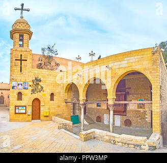 CAIRO, EGYPT - DECEMBER 23, 2017:The view on Coptic Church of The Great Martyr St George with huge cross on its bell tower, on December 23 in Cairo. - Stock Photo