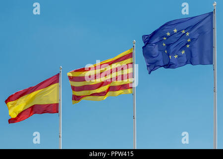 Flags of Spain, Catalonia and the European Union against the blue sky - Stock Photo