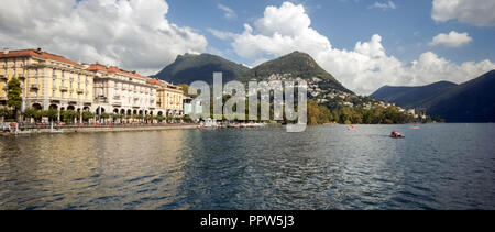 When taking a boat from Lugano to Gandria on the Lake Lugano you can enjoy gorgeous views on the city of Lugano in the canton of Ticino (Switzerland) - Stock Photo