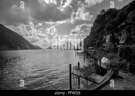 When walking the famous hiking trail from Gandria to Lugano (in the canton of Ticino, Switzerland) beautiful views can be had across the lake - Stock Photo