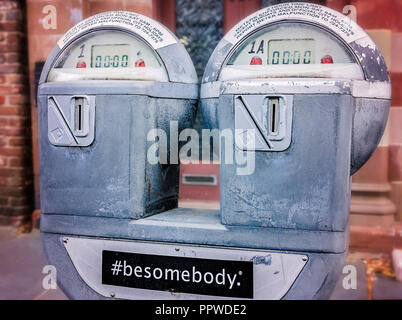 "Parking meters bear a sticker saying ""#besomebody"", April 5, 2015, in Charleston, South Carolina. - Stock Photo"