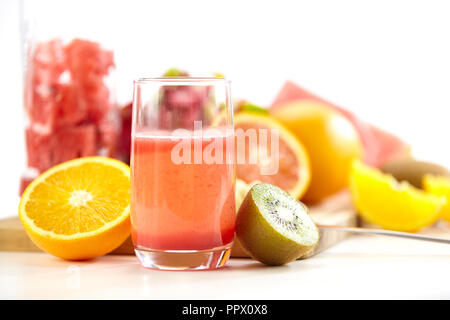 a glass of juice made from fresh fruits isolated on white background. - Stock Photo