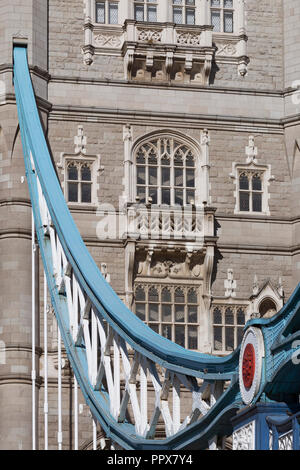 Detail of the southern end steel suspension chains and hangers plus the southern abutment tower of the Victorian-era Tower Bridge, on 27th September 2018, in London, England. - Stock Photo