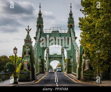 London, UK - September 18, 2018: View of Hammersmith Bridge, a suspension bridge that crosses the River Thames in west London. - Stock Photo