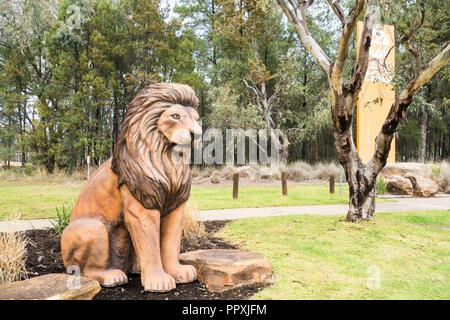Statue of a lion at entrance to Taronga Western Plains Zoo,Dubbo NSW Australia. - Stock Photo