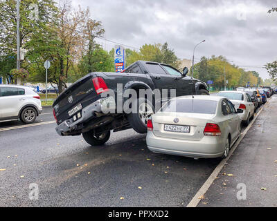 Moscow, Russia. 28th Sep 2018. The truck crashed into a number of cars and drove onto the roof of the car in a collision of several vehicles on September 28, 2018 in Moscow, Russia Credit: Dmitry Vinogradov/Alamy Live News - Stock Photo