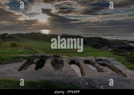 Heysham, Lancashire, 27th September 2018 Heysham Barrows St Patrick's Chapel reputedly to have held the bones of St Patrick himself and where made famous on the Black Sabbath LP cover under a cloudy sky at sunset Credit: Photographing_North/Alamy Live News - Stock Photo