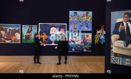Bonhams, New Bond Street, London, UK. 28 September, 2018. Works from the exhibition, including highly regarded artists such as Chéri Samba, Aimé Mpane, and Freddy Tsimba, will be offered at Bonhams Africa Now sale on Thursday 4 October. Credit: Malcolm Park/Alamy Live News. - Stock Photo