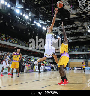 Copper Box Arena, London, 28th Sep 2018.Worcester's Miki Servena (13) jumps up to the basket for a point. Tensions run high in the British Basketball League (BBL) game between home team London Lions and opponents Worcester Wolves at the Copper Box Arena in the Queen Elizabeth Olympic Park, London. London Lions win 82:65. Credit: Imageplotter News and Sports/Alamy Live News - Stock Photo