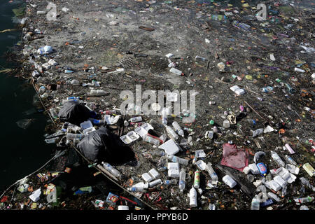 Plastic bottles, plastic bags, polystyrene and other trash floating on ocean in Semporna, Borneo, Malaysia - Stock Photo