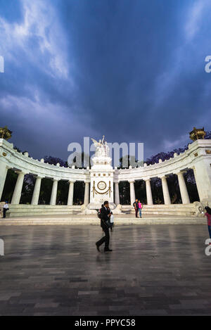 People visiting Benito Juárez Hemicycle in Alameda Central Park, Mexico City - Stock Photo