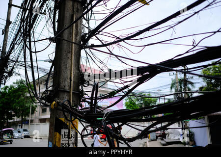Messy Electrical Cables on a Street in Chiang Mai, Thailand - Stock Photo