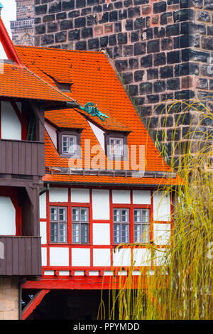 Icon city view of Nuremberg, Germany with half-timbered house and bridge in Bavaria - Stock Photo