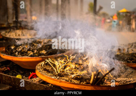 soil or clay lamp radiating light in dark. concept of removing darkness with a flame. this types of lamps are common in india and nepal, especially - Stock Photo