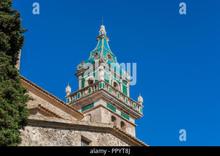 autiful view. Tower of the monastery in Valldemossa. Close to the Sierra de Tramuntana. - Stock Photo