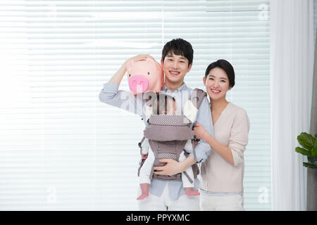 Young parents enjoying time spent with their little daughter, love and happy family concept photo 177 - Stock Photo
