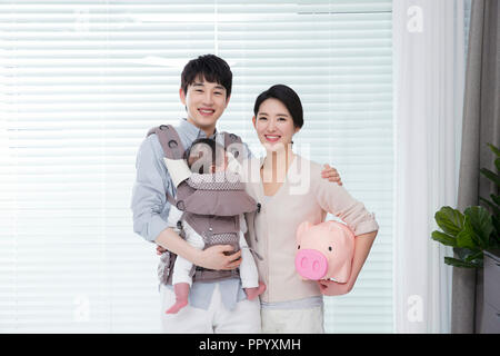 Young parents enjoying time spent with their little daughter, love and happy family concept photo 176 - Stock Photo