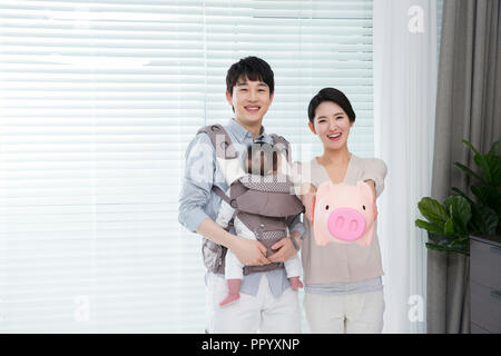 Young parents enjoying time spent with their little daughter, love and happy family concept photo 175 - Stock Photo
