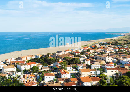 an aerial view of the Falaise district of Leucate, France, with the Leucate Plage beach and the Mediterranean sea on the left and the lagoon on the ri - Stock Photo