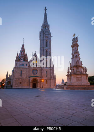 View of Trinity column and Matthias church in historic city centre of Budapest, Hungary. - Stock Photo