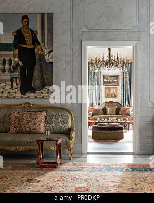 19th century French gilt sofa, with portrait of  Egyptian naval commander - Stock Photo