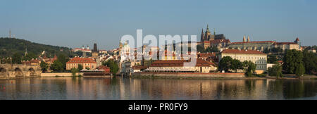 Panorama of Prague Castle, Hradcany, Mala Strana, and Charles Bridge lit by sunrise, UNESCO World Heritage Site, Prague, Czech Republic, Europe - Stock Photo