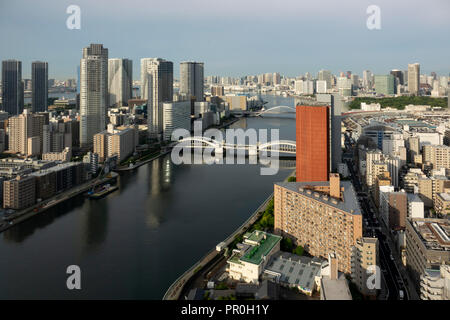 View over Sumida River with Kachidoki and Tsukiji-ohashi Bridges, Tokyo, Japan, Asia - Stock Photo