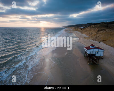 Aerial view of sunset over beach, by drone, Matalascanas, Huelva District, Andalucia, Spain, Europe - Stock Photo