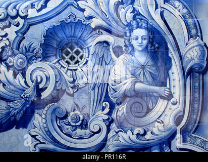 Portugal Typical old Portuguese 'azulejos' - blue and white ceramic tiles depicting an angel. - Stock Photo