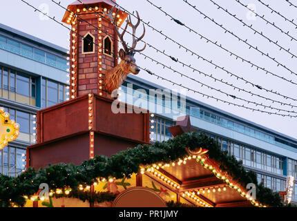 Decoration at Christmas Market at Kaiser Wilhelm Memorial Church in Winter Berlin, Germany. Advent Fair and Stalls with Crafts Items on the Bazaar. - Stock Photo