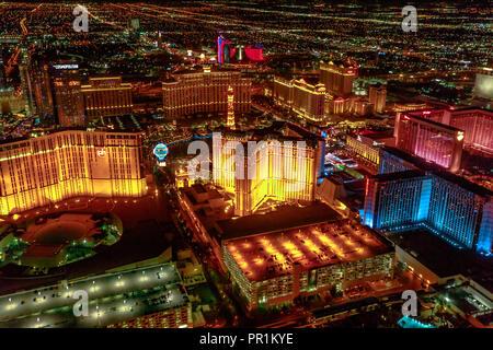 Las Vegas, Nevada, United States - August 18, 2018: aerial view of Las Vegas Strip Skyline illuminated by night. Scenic flight above: Cosmopolitan, The Paris Las Vegas and Bellagio Casino and Hotel. - Stock Photo
