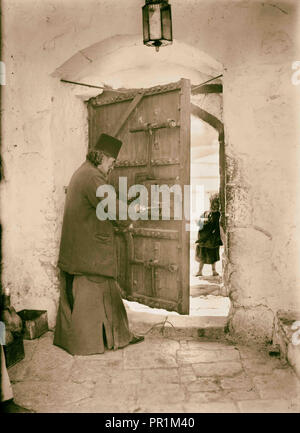 Mar Saba. Doorway with monk (looking out). 1934, West Bank - Stock Photo