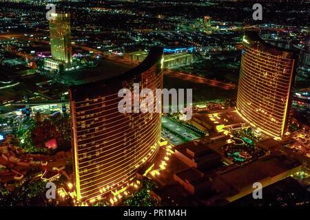 Las Vegas, Nevada, United States - August 18, 2018: aerial view of Las Vegas Skyline illuminated by night. Scenic flight above Wynn and Encore, Resort Hotel Casino 5-star in Las Vegas Strip. - Stock Photo