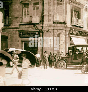 Corner of Grand Hotel showing American Colony stores and Dodge auto business (one of Am. Colony enterprises). 1920, Jerusalem - Stock Photo