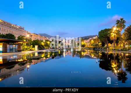 Night view of fountain at Place Massena at downtown Nice. French Riviera, France - Stock Photo