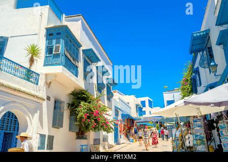 Main shopping street  in white blue town Sidi Bou Said. Tunisia, North Africa - Stock Photo